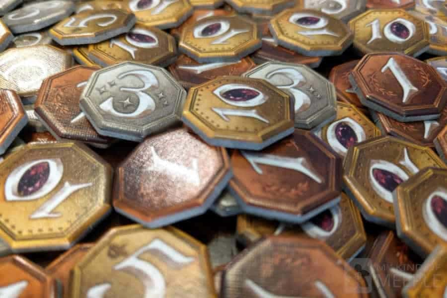 Coins from Small World board game to spend on expensive board games games