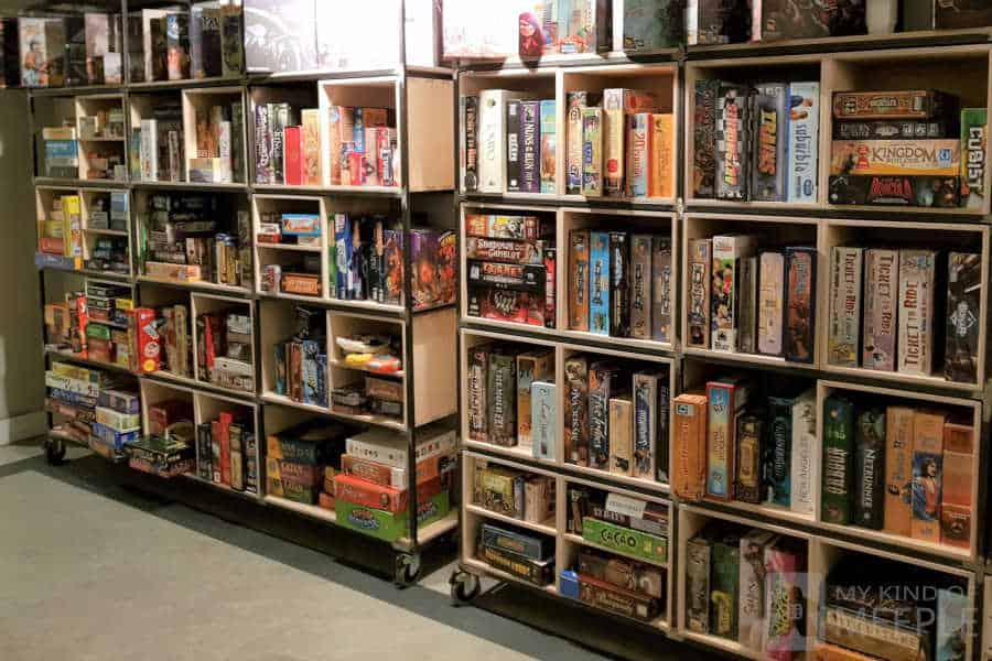 Board game shelves at The Treehouse board game cafe, Sheffield, UK