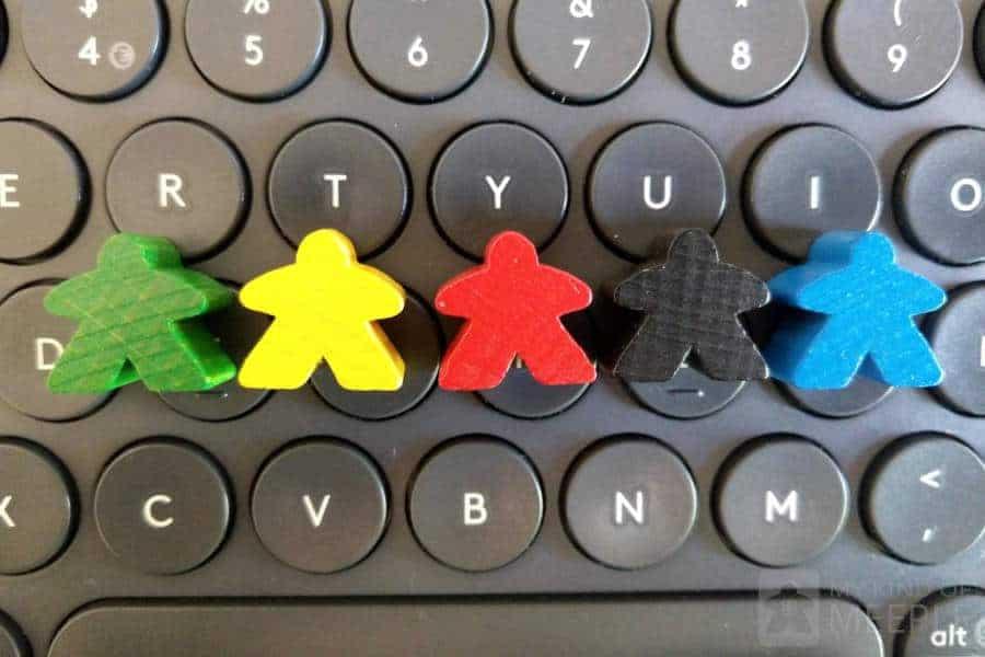 Meeples on a keyboard