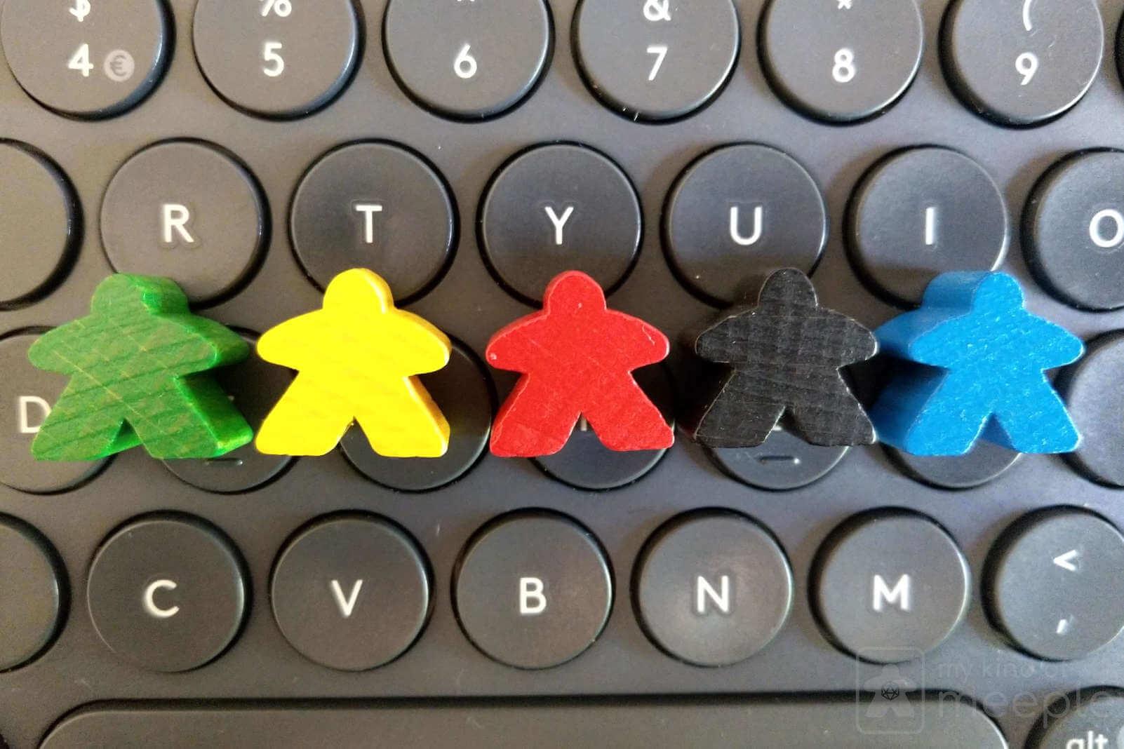 meeples on keyboard