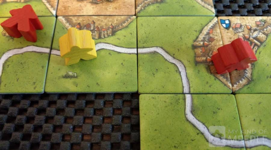 Non-slip liner under Carcassonne is a great board game accessory for tile games