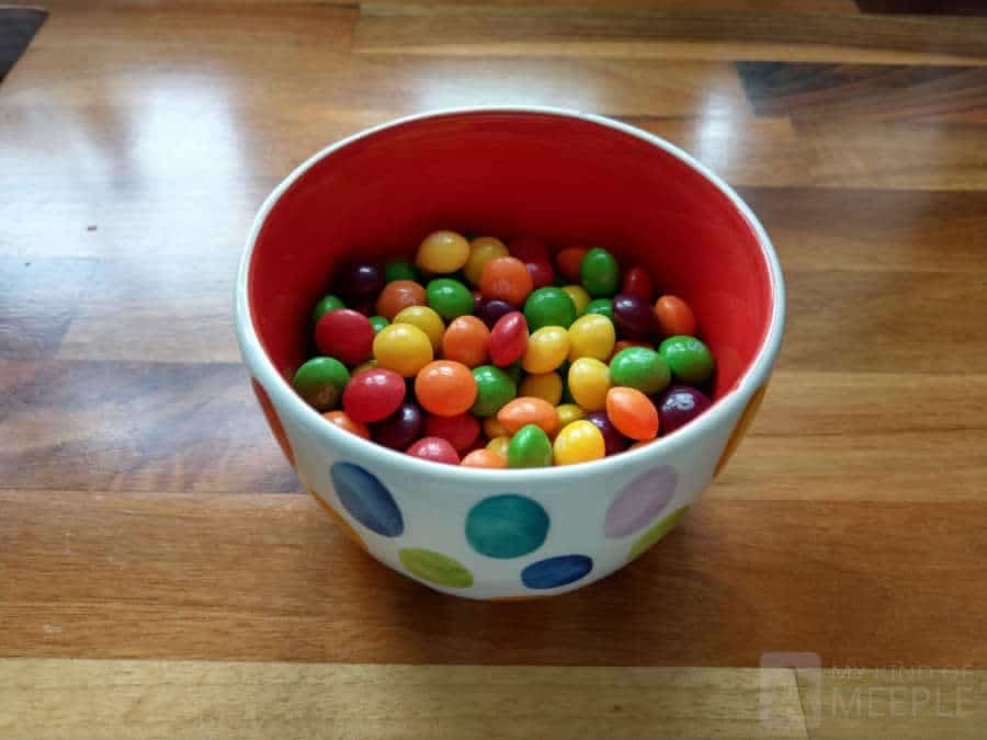 Skittles in a small snack dish