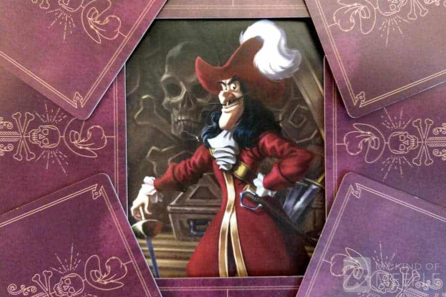 Captain Hook from Villainous surrounded by his cards
