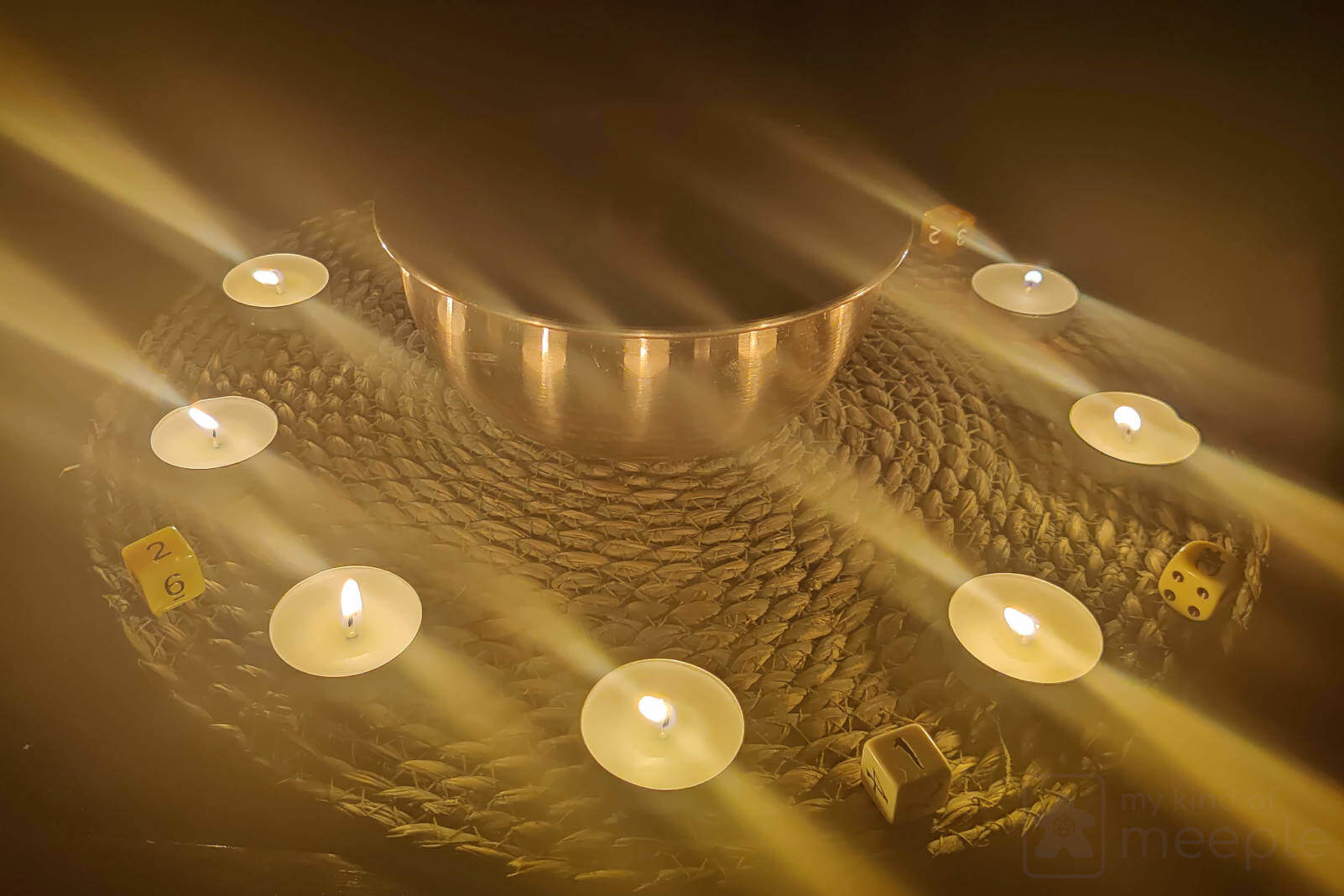 Ten candles around a fireproof bowl