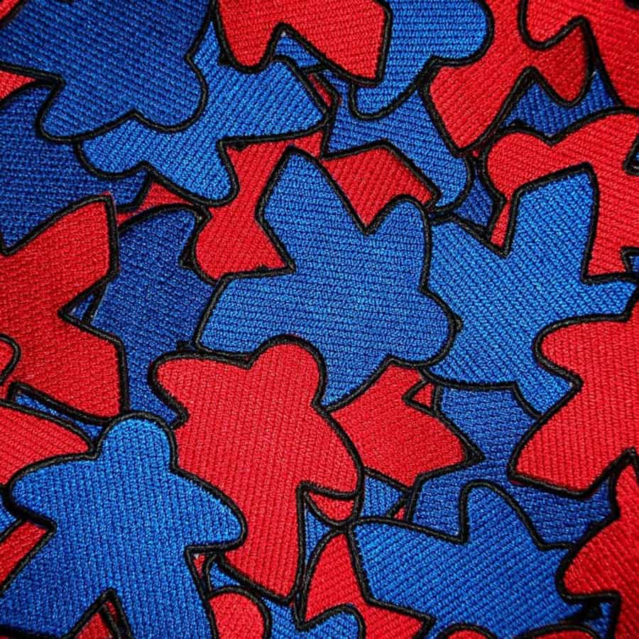 Red and blue meeple patches. Image credit: Geeky Goodies Shop on Etsy