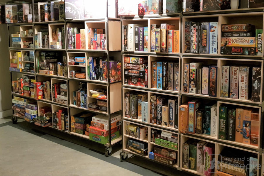Board game shelves at the Treehouse board game cafe Sheffield
