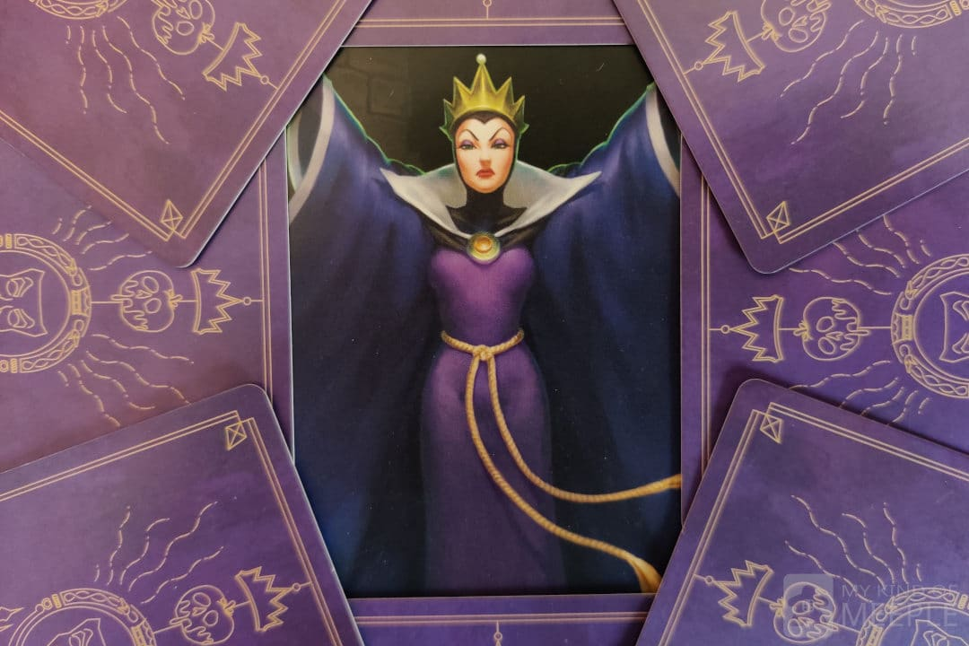 Evil Queen from Disney Villainous Wicked to the Core surrounded by her villain cards