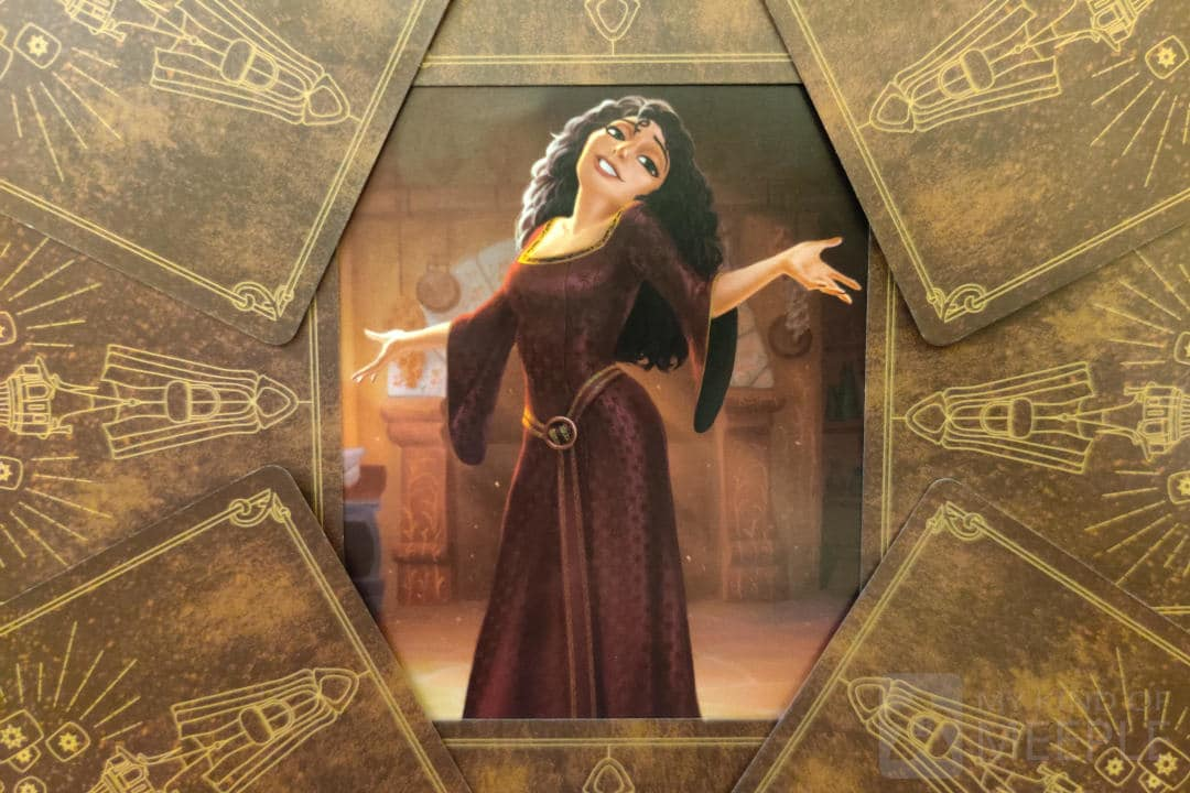 Mother Gothel from Disney Villainous surrounded by her villain cards