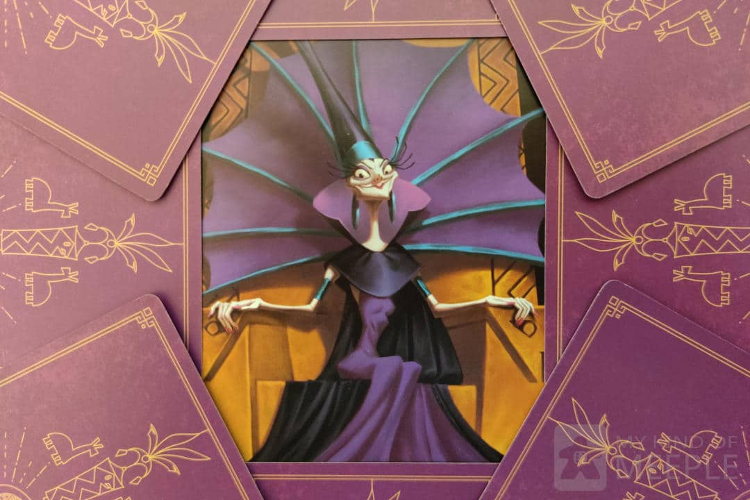 Yzma from Disney Villainous surrounded by cards from her Villain Deck