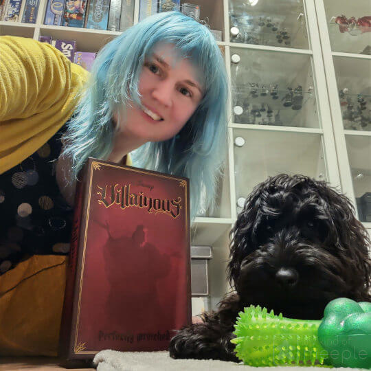 Emily and her dog Moxie with Villainous board game