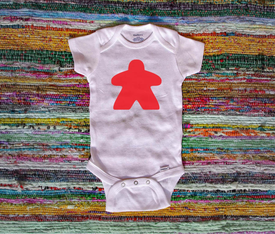 Meeple baby onesie. Image credit: Out Ind Kids on Etsy
