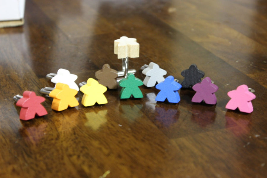 Meeple cufflinks. image credit Off the Cuff on Etsy