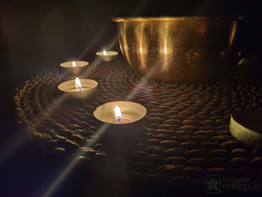Ten candles arranged around fireproof bowl