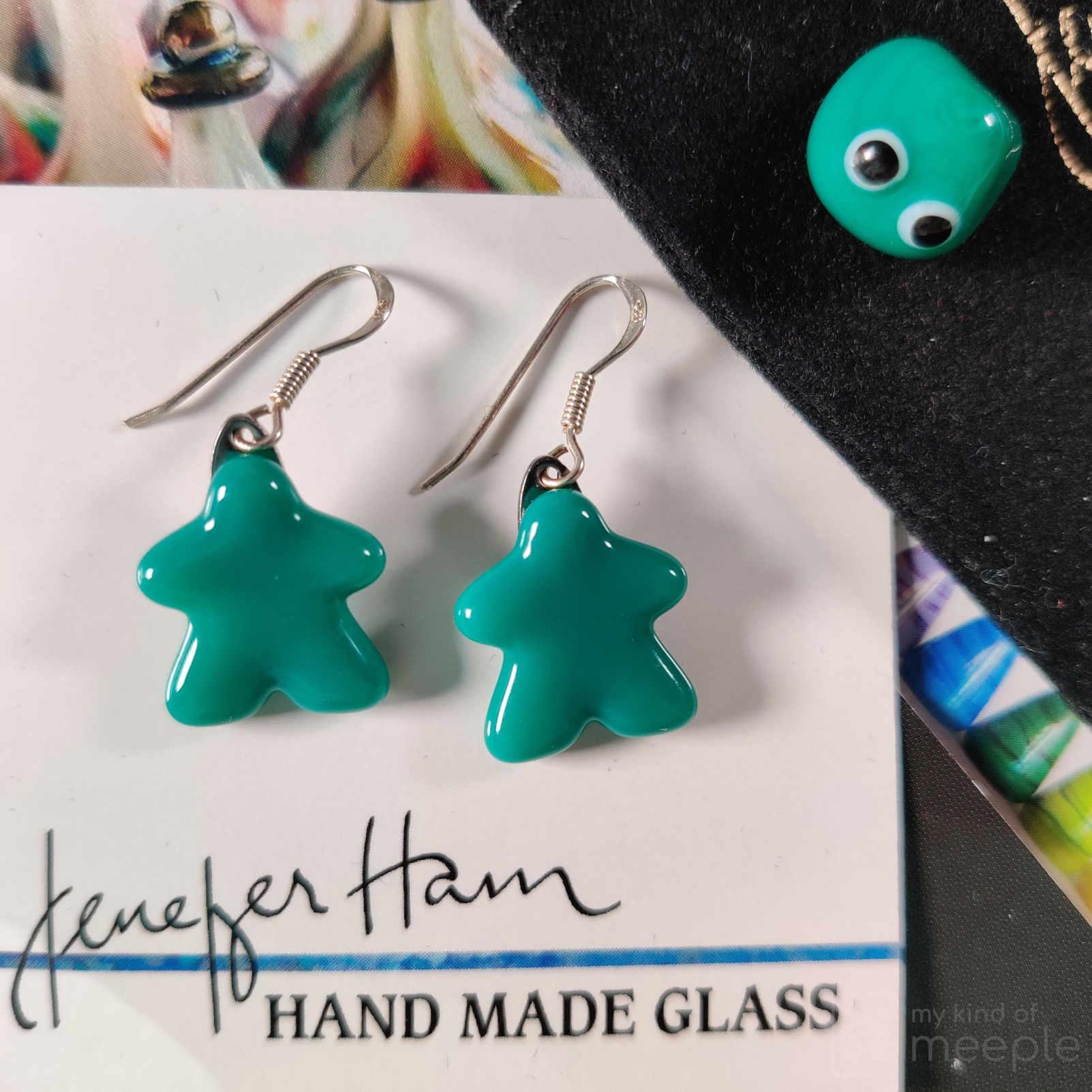 My teal meeple glass earrings made by Jenefer Ham Glass