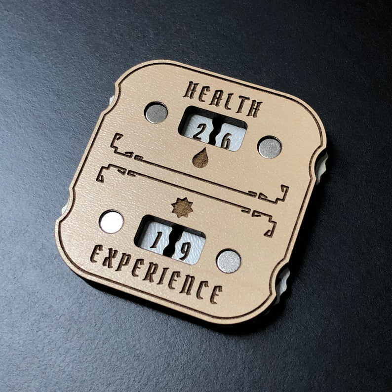 Gloomhaven health and exp trackers. Image credit: Schoonerlabs on Etsy.