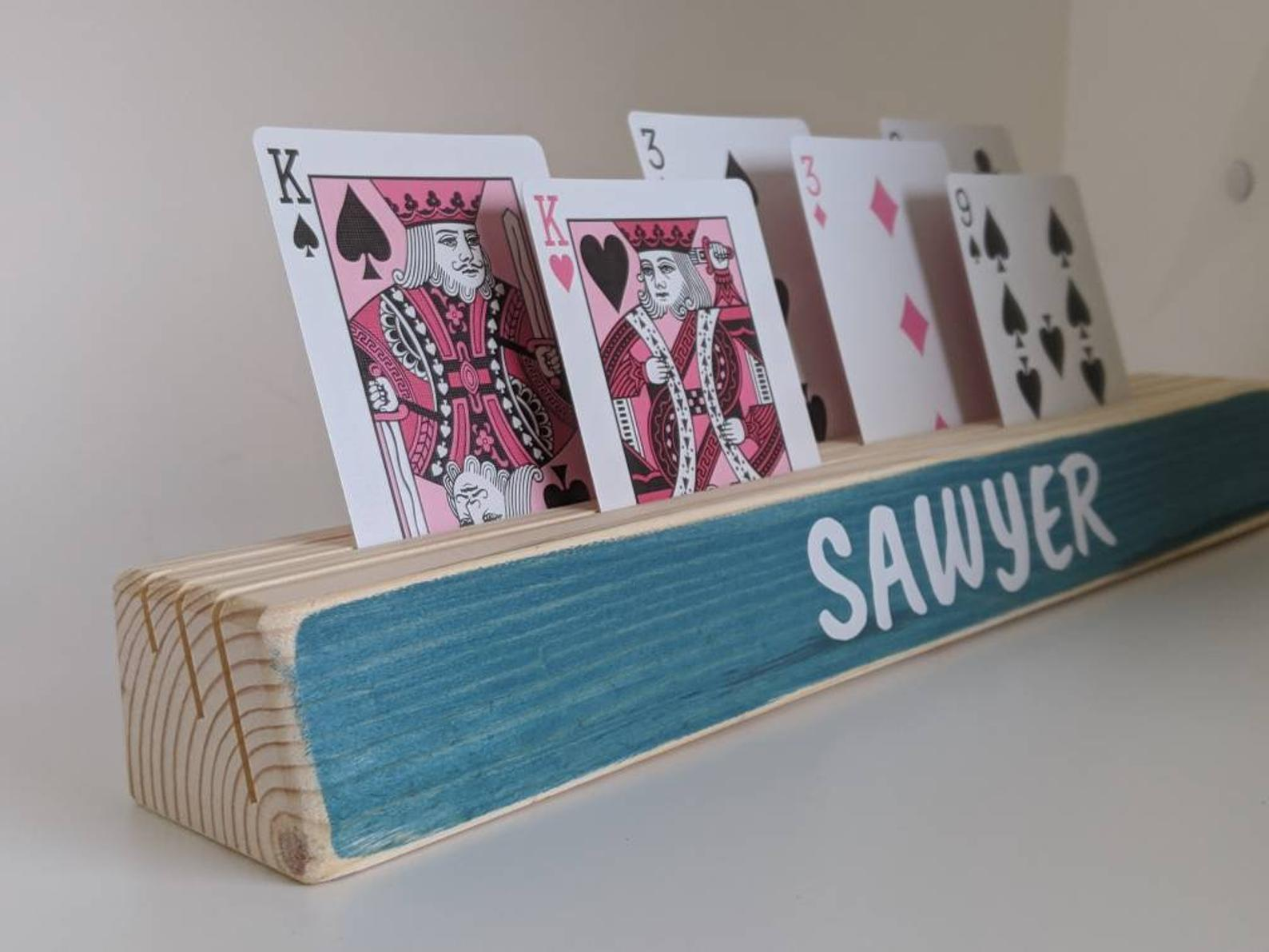 Wooden card holder. Image credit: SpeakeDesigns on Etsy.