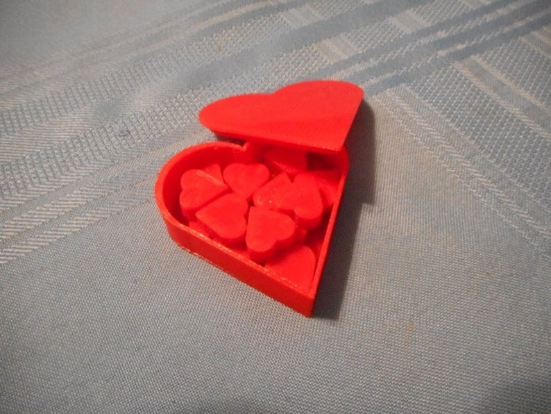 Love Letter heart tokens. Image credit: Piecesofgame on Etsy.
