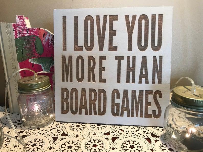 I love you more than board games sign. Image credit: Wingnut Laser on Etsy.
