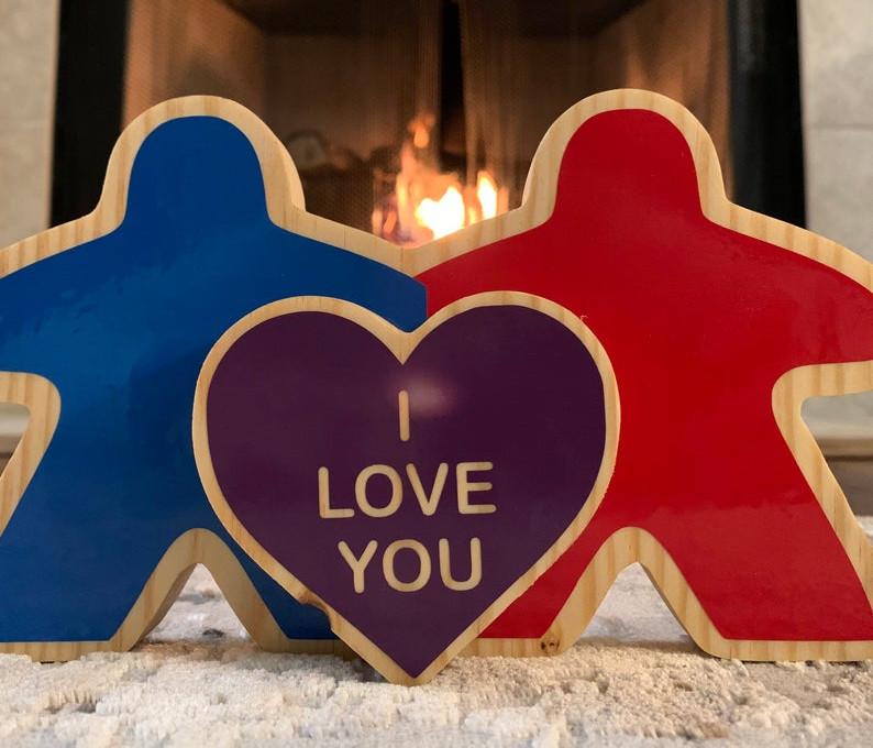 Wooden meeple couple - Image credit: SkeletonKey GDS on Etsy.