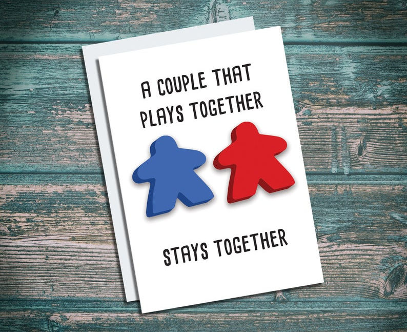 Meeple play together, stay together card. Image credit: TheNobleArtist on Etsy.