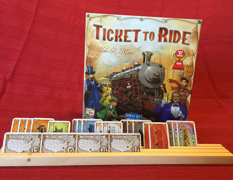Ticket to Ride card holder. Image credit: WoodWORKedForFun on Etsy.