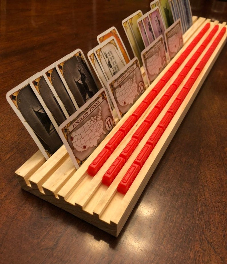 Ticket to Ride card and train holder. Image credit: WoodWORKedForFun on Etsy.