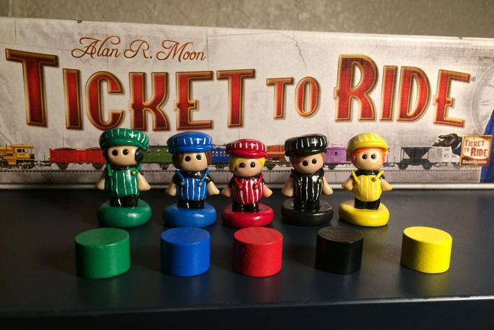 Ticket to Ride conductor player markers. Image credit@ MadeByMoin on Etsy.